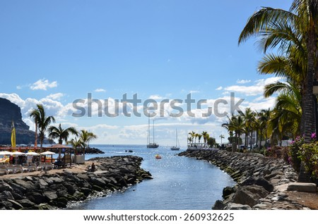 PUERTO DE MOGAN, SPAIN - FEBRUARY 13 ; View from the channel at Puerto de Mogan, a popular tropical resort at Gran Canaria, Spain. Pjoto taken on  February 13, 2015 in Puerto de Mogan, Spain - stock photo