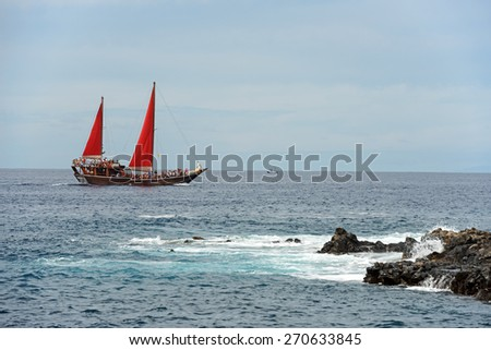 PUERTO DE SANTIAGO, SPAIN OCTOBER 08: Tourists are having a boat tour on the sailing motor yacht  on October 08, 2014 near Arena beach in Puerto de Santiago, Tenerife, Canary Islands, Spain. - stock photo