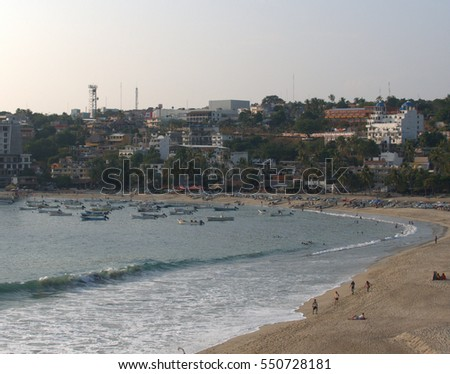 Puerto Escondido's economy is based largely on tourism and the inshore fishery. Elements of both these industries are shown in this shoreline picture of Bahia Principal taken from Playa Zicatela