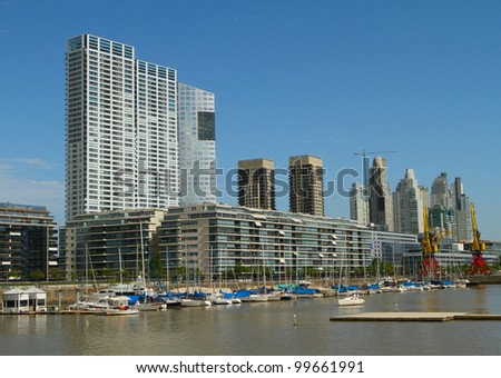 Puerto Madero is a district at Buenos Aires, occupying a significant portion of the Rio de la Plata riverbank and representing the latest architectural trends in the city of Buenos Aires. - stock photo