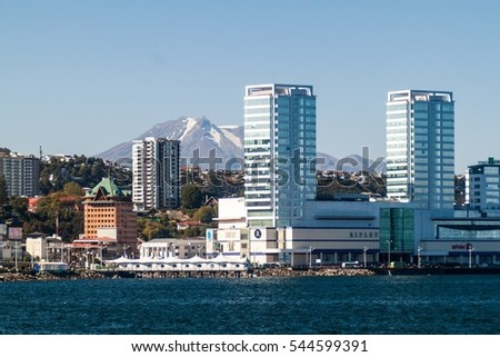 PUERTO MONTT, CHILE - MAR 23: Skyline of Puerto Montt city with Calbuco volcano in the background, Chile