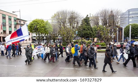 PUERTO MONTT, CHILE - November 14: Protesters during general strike. Government workers fighting for pensions, honor and justice, November 14, 2013 in Puerto Montt, Chile.  - stock photo