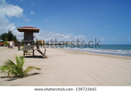 Puerto Rico Beach with Lifeguard Hut - stock photo