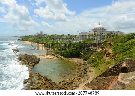 Puerto Rico Capitol (Capitolio de Puerto Rico) and Rocky Coast, viewed from Castillo de San Cristobal, San Juan, Puerto Rico. Castillo de San Cristobal is designated as UNESCO World Heritage Site - stock photo