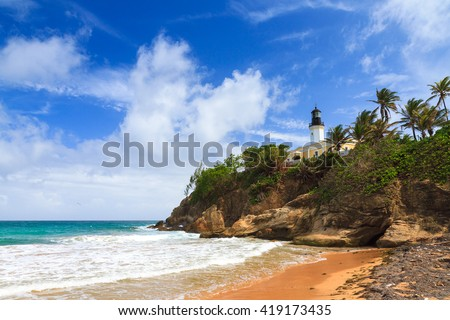 Puerto Rico coastline beach at Punta Tuna lighthouse in summer with a blue sky and clouds - stock photo