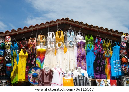 PUERTO VALLARTA, MEXICO-AUGUST 11 : Souvenir market on August 11, 2010 in Puerto Vallarta, Mexico. The small market, located in port area where you can to buy the colorful Mexican folk art items. - stock photo