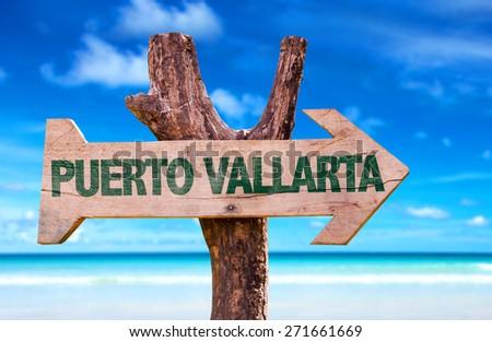 Puerto Vallarta wooden sign with beach background - stock photo