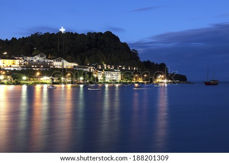 Puerto Varas, Chile seen after sunset accross the lake - stock photo