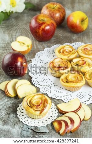 Puff apple shaped roses. Homemade apple cake. Sweet cupcake. Gourmet cupcakes. Sweet dessert. Sweet pastry. Homemade dessert. Homemade pastry. Apple dessert. Apple pastry.  - stock photo