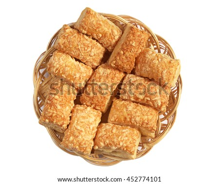 Puff cookies with cheese in wicker plate isolated on white background, top view