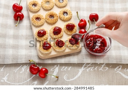 Puff pastry cookies filled with strawberry jam - stock photo
