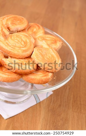 Puff pastry cookies on a glass bowl