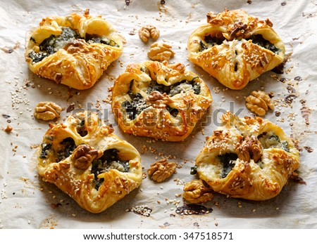 Puff pastry filled with spinach and  blue cheese. Delicious appetizer - stock photo