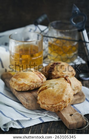 Puff pastry pies with mince meat. - stock photo