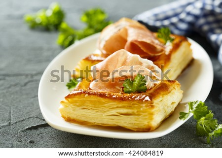 Puff pastry pies with red pesto and ham - stock photo