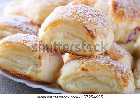 Puff pastry roll with cottage cheese -  close up - stock photo