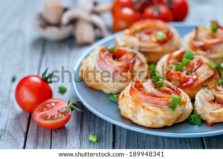 Puff pastry rolls with ham  and cheese. Baked snack - stock photo