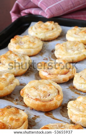 Puff pastry rolls with ham, salami and cheese - stock photo