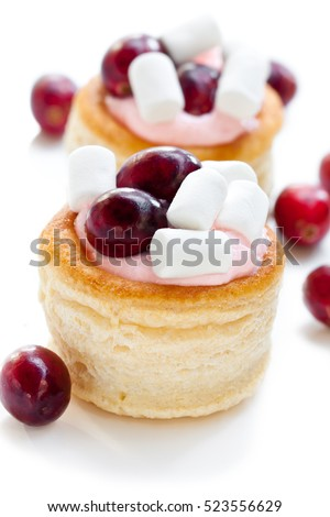 puff  pastry stuffed with fruity soft cream cheese and cranberry on white background