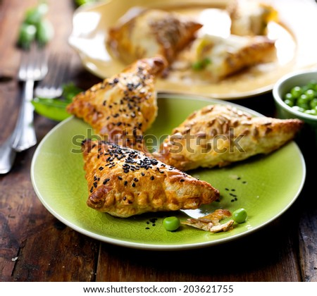 Puff pastry stuffed with green peas - stock photo