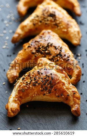 Puff pastry stuffed with mushrooms - stock photo