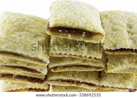 Puff pastry topped with sugar and pineapple filling is snacks of Thailand are served with tea or coffee. - stock photo