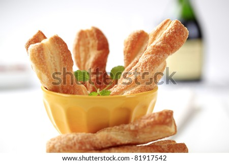 Puff pastry twists sprinkled with sugar   - stock photo