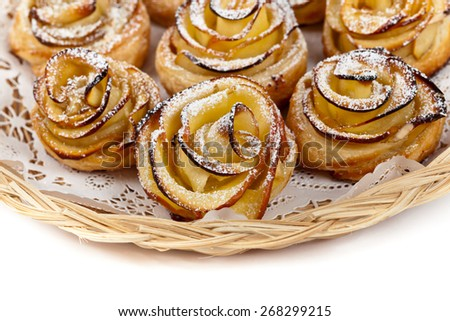 Puff pastry with apple shaped roses. Selective focus. - stock photo