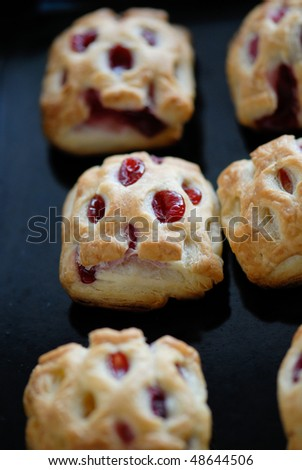 Puff pastry with cherry - stock photo