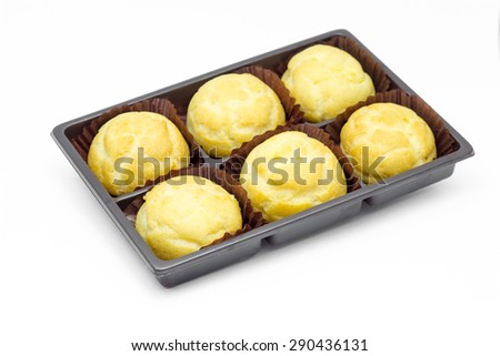 Puff pastry with fresh custard creams on white background.