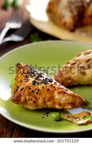 Puff pastry with green peas - stock photo