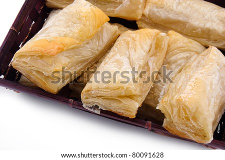 Puff pastry with potato and cabbage on plate - stock photo