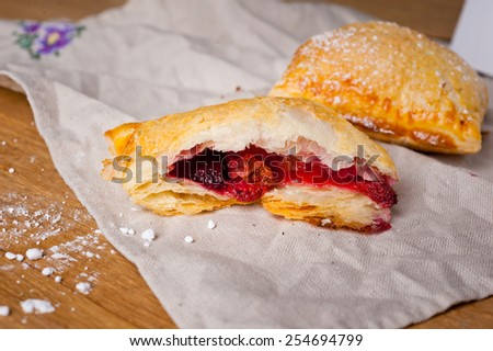 Puff with berry filling. - stock photo