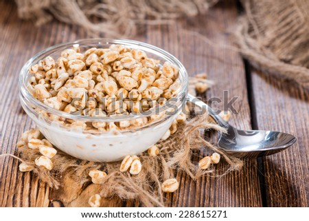 Puffed wheat breakfast cereals with honey and milk - stock photo