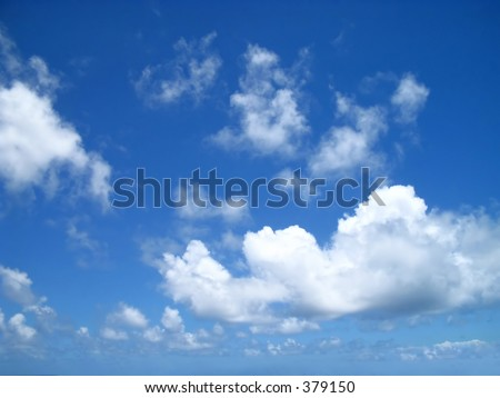Puffy clouds drifting in on a sunny day on the Windward side of Oahu, Hawaii - stock photo