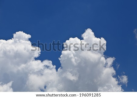 Puffy clouds in blue sky - stock photo