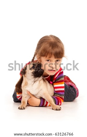 Pug-dog bitting the cheek of little girl  isolated on a white background