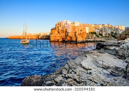 Puglia, Italy. Sunset scenery of Polignano a Mare, town in the province of Bari, Apulia, southern Italia on the Adriatic Sea - stock photo