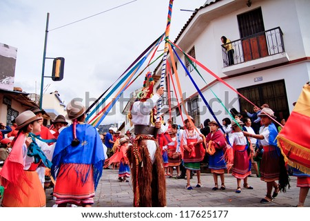 PUJILI, ECUADOR - 25 JUNE : indigenous group dancing around pole in traditional costume, Inti Raymi festivities, 25 June 2011 PUJILI, ECUADOR