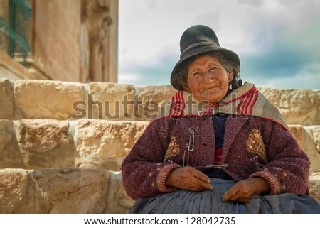PUKARA PERU -JANUARY 15: Quechua indian woman welcomes tourists in Pukara, Peru on January 15, 2013. Pukara is a popular destination for tourism in Peru. - stock photo