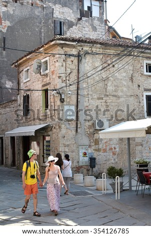 PULA, CROATIA - JULY 18, 2015: tourists visiting the narrow streets in the historic city of Pula in Croatia - stock photo