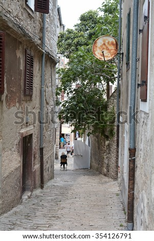 PULA, CROATIA - JULY 13, 2015: tourists visiting the narrow streets in the historic city of Pula in Croatia - stock photo
