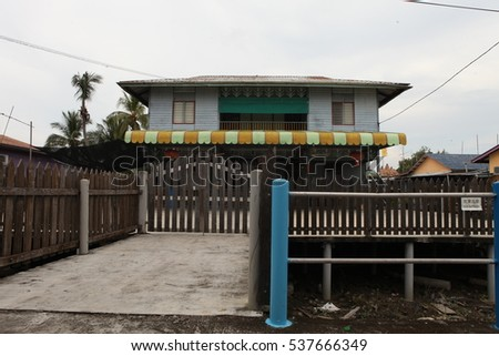 PULAU KETAM, MALAYSIA - December 8 2016: A view of a fishermen's village on stilts besides the sea in Pulau Ketam (Crab Island). This island is famous for sea food products and restaurants.