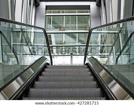 Pulkovo International Airport, Saint Petersburg, Russia - May 25, 2016: Modern architecture series. View of escalator - stock photo