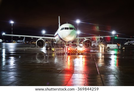 Pulkovo (LED) Airport, Saint Petersburg, Russia - January 28, 2016: Ground crew prepared the aircraft for take-off - stock photo