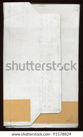 pull here to open - corrugated cardboard postage parcel still unopened - stock photo