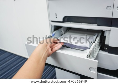 Pull piece of paper from the printer tray