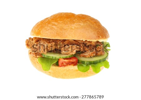Pulled pork and salad bread roll isolated against white