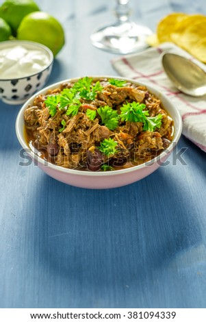 Pulled pork in a bowl ready to be eaten - stock photo