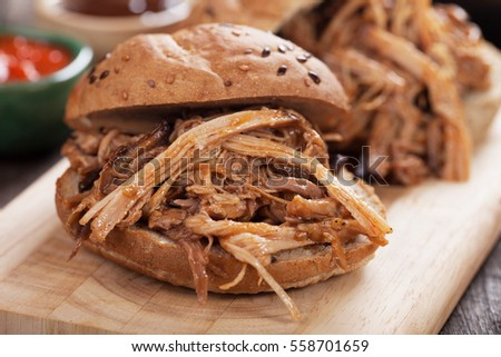 Pulled pork meat sandwich in whole grain burger bun